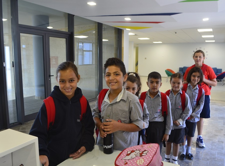 Photos of the REA premises as well as Pupils in their classes